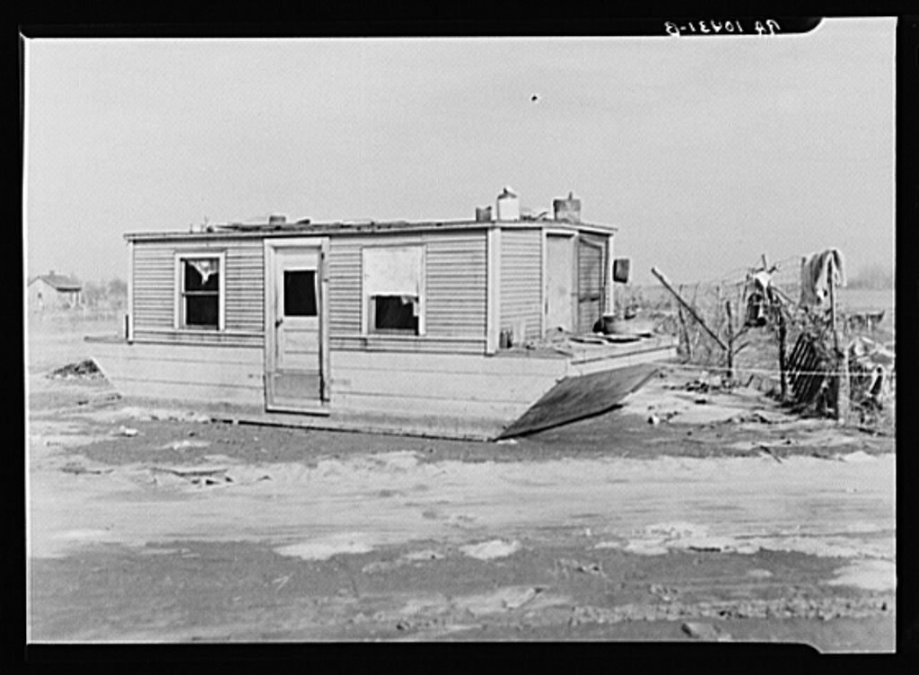 Houseboat washed high and dry amid debris. Maunie, Illinois-1930