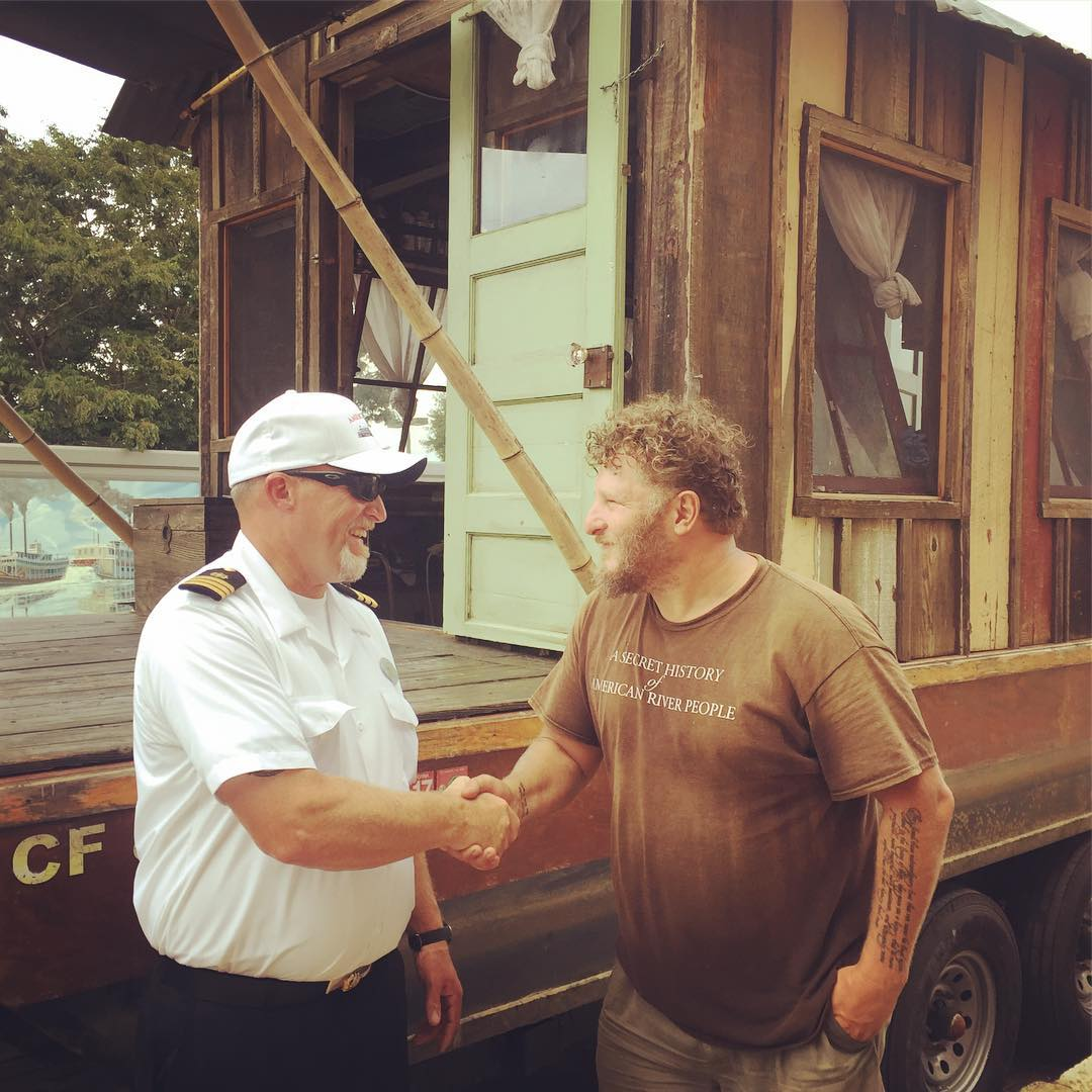 Capt Ron Gray Jr of the American Queen meets the captain of the Shantyboat Dotty