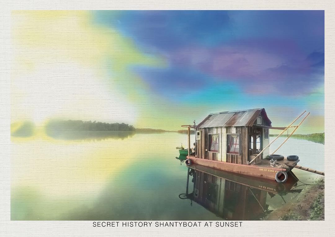 """Secret History shantyboat at sunset"