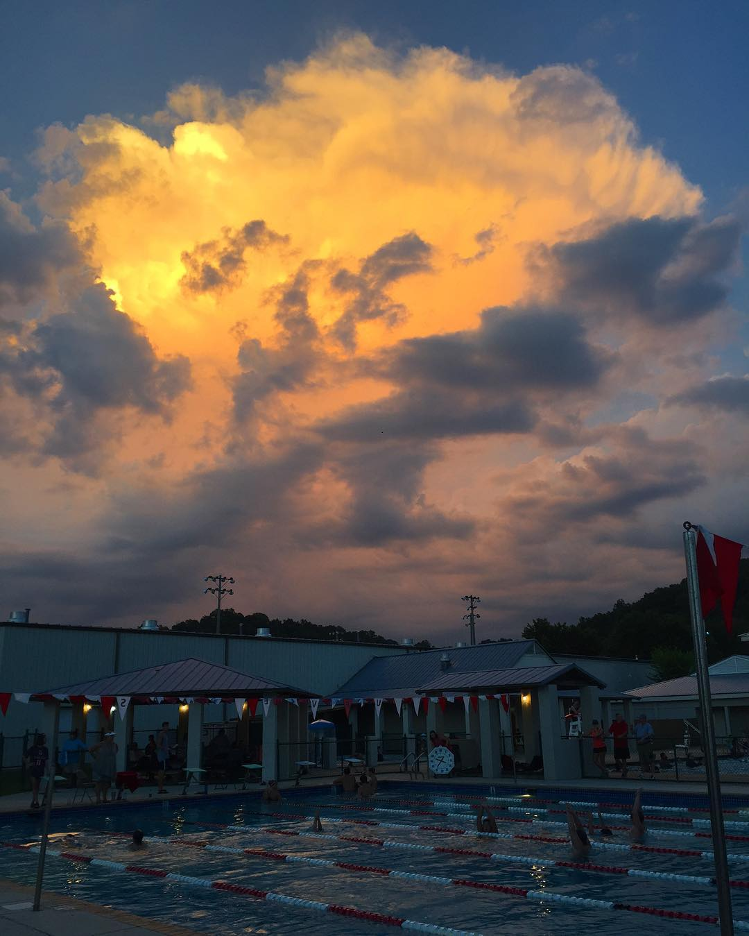Moments before lightening in the distance cleared the - Guntersville public swimming pool ...