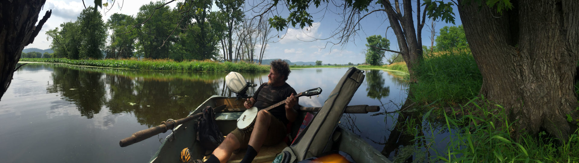 Artist and shantyboat captain Wes Modes relaxes in the johnboat on the Mississippi River near Brownsville, Minnesota.