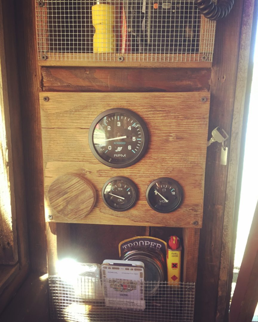Gauges in the shantyboat's pilot's corner.